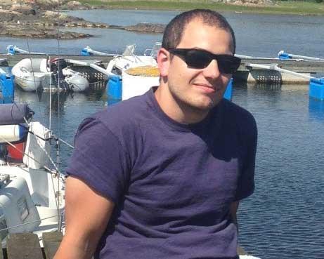 Dustin Norton sitting on a dock.